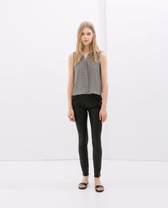 Image 1 of VARNISH EFFECT TROUSERS from Zara