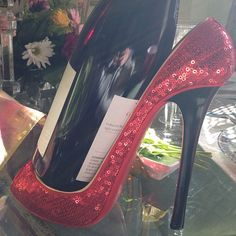 Combine your passions. A high heel shoe as a wine bottle holder.