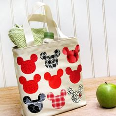 Using colorful printed fabrics, kids can cover a plain canvas tote bag with a striking Mickey Mouse mosaic.