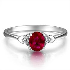 Beautiful ruby in a simple and elegant engagement ring band.