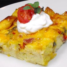 Baked Breakfast Omelet | A baked egg casserole with cheese, ham and green onions.