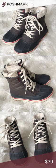 3ff3d7df13acf9 CROCS waterproof winter boots Black brown and off white with red detailing.  Smoke free home