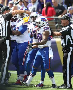 Bills-Ravens:    Monday, September 12, 2016  -   Buffalo Bills defensive tackle Leger Douzable (91) sacks Baltimore Ravens quarterback Joe Flacco in the fourth quarter.  -   James P. McCoy / Buffalo News News Sports Photographer James P. McCoy captured outstanding images from the Bills' season-opening loss in Baltimore. Here are our favorites