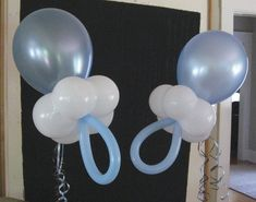 Pacifier balloons for a baby shower