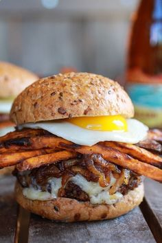 Epic Crispy Quinoa Burgers Topped with Sweet Potato Fries, Beer Caramelized Onions   Gruyere and fried egg!!!