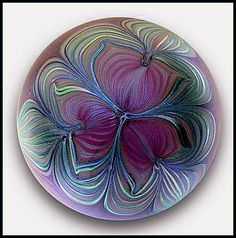 """Zellique Studio 1982: Art nouveau design paperweight. An iridescent art nouveau surface design paperweight made in the early years of Zellique Art Glass. This rich mauve and green paperweight is signed (Zellique Studio) and dated (1982). Diameter: ~2¾"""". SOLD. (#P140)"""