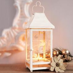 Clever lantern! The heat from tealights spin the removable metal insert. Two displays, the soaring birds insert for the spring and summer and swirling snowflakes for the colder seasons keep this lantern in season throughout the year.