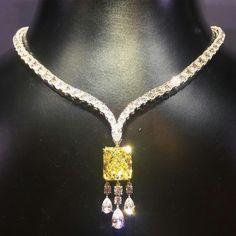 RonaldAbram Pear Shape Diamond Necklace featuring a 9.04 carat Fancy Yellow Diamond Pendant