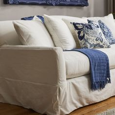 Add distinction and character to your living space with the Fairchild Sofa. Slender track arms and blended down pillows offer chic comfort, while the tailored slipcover includes a charming skirt and is removable for easy washing.