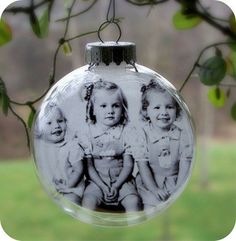 awesome christmas gift! photo printed on vellum and inserted into a glass ornament