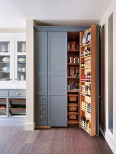 This traditional kitchen features a gorgeous built-in pantry with gray doors and a wooden interior with plenty of shelves and drawers for multipurpose storage Kitchen Pantry Design, Kitchen Pantry Cabinets, Diy Kitchen Storage, Pantry Storage, Kitchen Organization, New Kitchen, Organization Ideas, Kitchen Decor, Base Cabinets