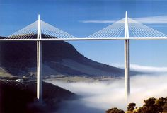 On the Paris-Montpellier autoroute, one encounters le Viaduc de Millau, the World'sTallest Bridge (designed by Norman Foster and engineered by Michel Virlogeux). A centre mast's summit hovers 343.0 metres above its base (higher than the Eiffel tower).
