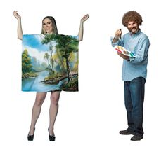 Adult size Bob Ross Couples Costume - Bob Ross Kit and/or Painting  Dress up as everyone's favorite celebrity art instructor, Bob Ross! With his soft voice and friendly trees, he brought lots of joy to painting! Bob Ross Kit includes permed afro style wig, paint palette, and paintbrush. Add you own shirt and jeans to complete the look.  Bob Ross Painting Costume includes tunic style dress printed with a Bob Ross painting filled with friendly trees.
