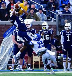 Chattanooga wide receiver Alphonso Stewart (left) goes up for a pass during the Mocs' game with Indiana State in the FCS playoffs. (RoadTripSports photo by Kendall Webb)