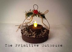 Handmade ornaments out of painted canning lids with battery tealight
