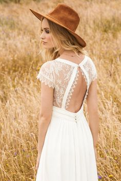 Rembo Styling dress 'Aimee'. What an beautifully understated gown with modern lace details. The back keyhole is amazing and the light weight feel to the dress will make you want to run through the fields!