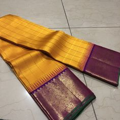 Fantastic handwoven pure kanjivaram silk in a beautiful mustard with purple combination with contrast woven meenakari borders rich pallu and contrast woven blouse cost