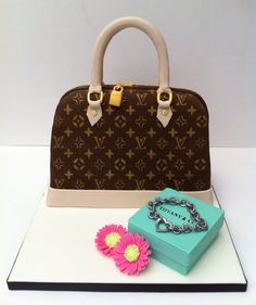 - My first handbag cake, everything on the board is edible (apart from the plastic tubing supporting the handles.