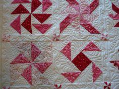 diff blocks, similar colours. NB sashing with pinwheels