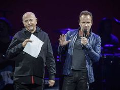 English musicians Peter Gabriel, left, and Sting, right, speak to the audience during their performance at the Bell Centre in Montreal as part of their Rock Paper Scissors tour on Tuesday, July 5, 2016.