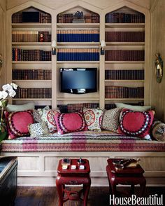 """Bookcase arches in the library mimic Belgian castle windows. Niven adores the leather-bound books she inherited, but says, """"I didn't want the room to be dark or stiff,"""" so she introduced inviting colors to make it a favorite retreat."""