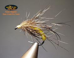 A fast and simple pattern to tie but very effective on caddis pupa hunting trout. Just yellow tying thread with Deer Creek Diamond Fine Flex, some squirrelhair and a few straws of curled mallard By Peder Wigdell