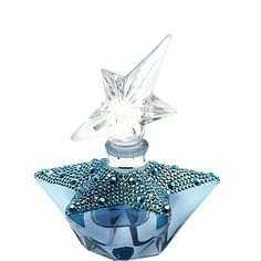 Angel Midnight Star Extrait de Parfum - The art of refined perfume meets the delights of feminine indulgences when the ANGEL Extrait de Parfum comes to life. In honor of the 20th Anniversary of Thierry Mugler Parfums, this rare and special bottle is dressed in dazzling midnight blue Swarovski crystals.