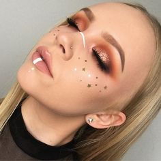 WEBSTA @ nicoleetait - My take on a festival look. Super orange eyes, gold star freckles and random white lines  @inglot_australia eyeshadows 335 298 299 287 291@eyekandycosmetics glitter in taffy @anastasiabeverlyhills brow wiz and powder in taupe and nicole g glow kit ❤