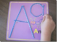 ideas for learning the alphabet. I saw a Montessori teacher using similar methods...gonna give it a shot!