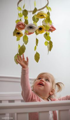 Download the template to make your own felt flower mobile to hang in your baby's nursery or to give as a pretty baby shower gift! By designer Lia Griffith