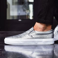 Vans Silver Grained Leather Slip-On Sneakers Shine and stand out with these silver sneakers from Vans that elevate every outfit. Features grained leather uppers with silver foil + a cushioned footbed for comfort. Completed with contrast stripe & the signature waffle tread sole + logo detailing.  Content & Care - Leather, textile, rubber - Spot clean - Imported  NOTE: 9.5 has NO BOX, but has tags; 7.5 has box without lid  Photos 2,3,4 photographed by me. Item's color may slightly vary from…