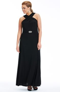 Dream Diva Cross over neckline gown Black        Style No: ED5113  Heavy weight Jersey evening dress.  This stunning full length dress has a dramatic cossover front neckline.  It is waisted and has a lovely diamante clasp belt on a wide full draped skirt. #fashion #2013 #plussize