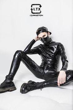 Latex bondage boy