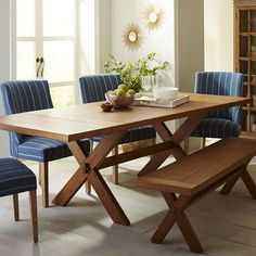 Crafted of hardwoods and defined by rustic details—including X-shaped supports, a java stain and a warm lacquered finish—the Nolan dining table and matching bench, are quite literally, crowd-pleasers. Drop in Nolan's two breadboard leaves, each measuring 16 inches, and you can accommodate 10 or more along the 96-inch plank top. Mix this with the Corinne dining chair, which offers a chic stripe pattern, padded seat and solid wood legs for deluxe style and comfort.