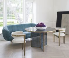 KELLY WEARSTLER | FRACTURED TABLE. Each panel of tempered glass is hand-fractured, creating a juxtaposition of materials with an elegant antique brass edge banding.