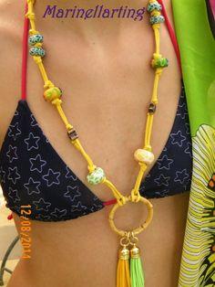 Collana o ferma-pareo? Necklace or saron tieng?