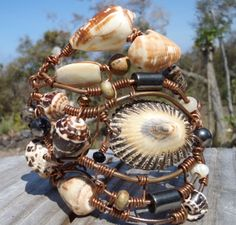 Large Shells found on a remote Beach in South Kona Hawaii. Copper is from an Electric Job. Scalped with Love.   I  truck down a 4x4 road for 6 miles to get to this remote beach, camp out  and shell hunt. I then bring my shell treasures home and start the  careful shell drilling.  Made by Carmen