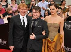 "(L-R) Rupert Grint, Daniel Radcliffe and Emma Watson at the New York premiere of ""Harry Potter And The Deathly Hallows: Part 2"" on July 11, ..."