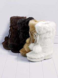 "Colin Stuart Faux Fur Pom Pom Boot: A foxy look makes animal tracks. This season, faux is the way to go. A totally warm and furry boot.    Pulls on  Front tie with back zip  1 1/2"" rubber lug sole  Imported polyester  $99"