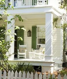 Cream siding, white trim, green shutters...with red door! Gorgeous!!!!  Ok get the paint brushes ready!