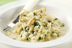 Risotto can be diversified with vegetables like peas and mushrooms.
