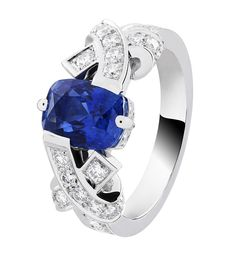 Van Cleef & Arpels Entrelacs Solitaire in platinum, set with round diamonds and a 2.28ct cushion-cut sapphire.