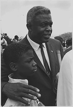 Jackie Robinson with his son at the March on Washington, 1963