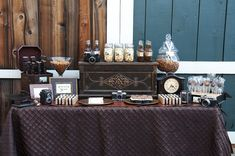 Another groom's dessert table- I love the decor too (old cameras, clock, trunk)!