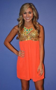 This coral and gold dress is tots adorable! I wish I had this dress