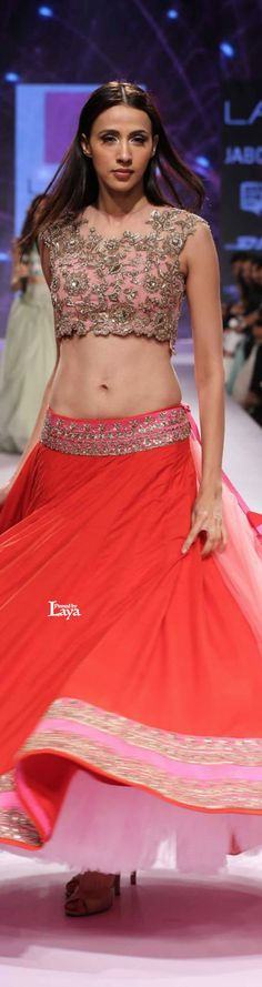 Red lehenga with pale pink embroidered blouse