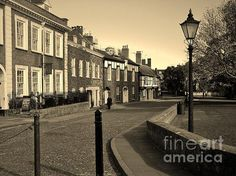 The attractive Cathedral Close, Exeter, Devon UK. Photo by & copyright Richard Brookes. (FAA watermark not included on purchased item).