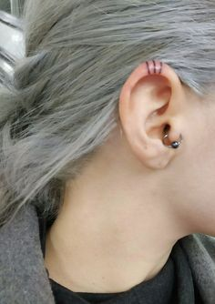 In-ear tattoo made with stick and poke