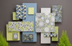 Made from scrapbook papers and Styrofoam. Wrapping paper would probably work also. See http://www.michaels.com/Garden-Collage-Wall-Art/e08674,default,pd.html?start=109=projects-homedecor-walldecor
