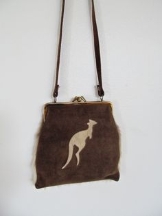 Australian Vintage Kangaroo Leather and Fur Purse- Tan, Cream, and Gold. $16.00, via Etsy.